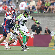 Jerry Ragonese #37 of the New York Lizards tries to keep Kyle Sweeney #77 of the Boston Cannons away from the ball during the game at Harvard Stadium on July 19, 2014 in Boston, Massachusetts. (Photo by Elan Kawesch)