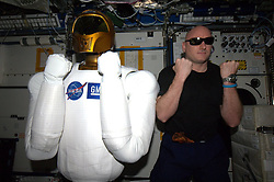 """Scott Kelly releases a photo on Twitter with the following caption: """"""""The future is so bright, we got to wear shades. Happy #NationalSunglassesDay!"""""""". Photo Credit: Twitter *** No USA Distribution *** For Editorial Use Only *** Not to be Published in Books or Photo Books ***  Please note: Fees charged by the agency are for the agency's services only, and do not, nor are they intended to, convey to the user any ownership of Copyright or License in the material. The agency does not claim any ownership including but not limited to Copyright or License in the attached material. By publishing this material you expressly agree to indemnify and to hold the agency and its directors, shareholders and employees harmless from any loss, claims, damages, demands, expenses (including legal fees), or any causes of action or allegation against the agency arising out of or connected in any way with publication of the material."""