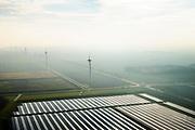 Nederland, Groningen, Delfzijl, 04-11-2018; Sunport Delfzijl, het grootste zonne-energiepark van Nederland. Het park levert onder andere stroom aan het Google datacentre in de nabij gelegen Eemshaven. In de achtegrond windmolens.<br /> Sunport Delfzijl, the largest solar energy park in the Netherlands. The park supplies power to the Google data center in the nearby Eemshaven.<br /> <br /> luchtfoto (toeslag op standaard tarieven);<br /> aerial photo (additional fee required);<br /> copyright&copy; foto/photo Siebe Swart