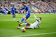 Leicester City defender Ben Chilwell (3) tackled by Burnley's Matthew Lowton during the Premier League match between Leicester City and Burnley at the King Power Stadium, Leicester, England on 10 November 2018.
