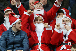 Cheltenham Town's fans dressed as Santa during the match at the Ricoh Arena