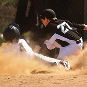 A young baseball player slides into third base during the Norwalk Little League baseball competition at Broad River Fields,  Norwalk, Connecticut. USA. Photo Tim Clayton