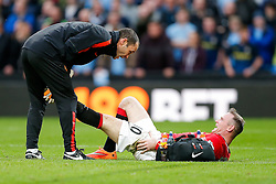 Wayne Rooney of Manchester United cramps up after colliding with Joe Hart of Manchester City - Photo mandatory by-line: Rogan Thomson/JMP - 07966 386802 - 02/11/2014 - SPORT - FOOTBALL - Manchester, England - Etihad Stadium - Manchester City v Manchester United - Barclays Premier League.