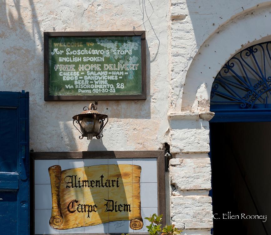 Signs for a deli in Santa Marino on the island of Salina inThe Aeolian Islands, Messina, Sicily, Italy
