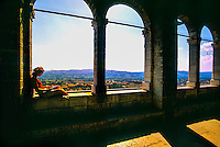 Italian woman relaxing at the Palazzo dei Consoli, Gubbio, Umbria, Italy