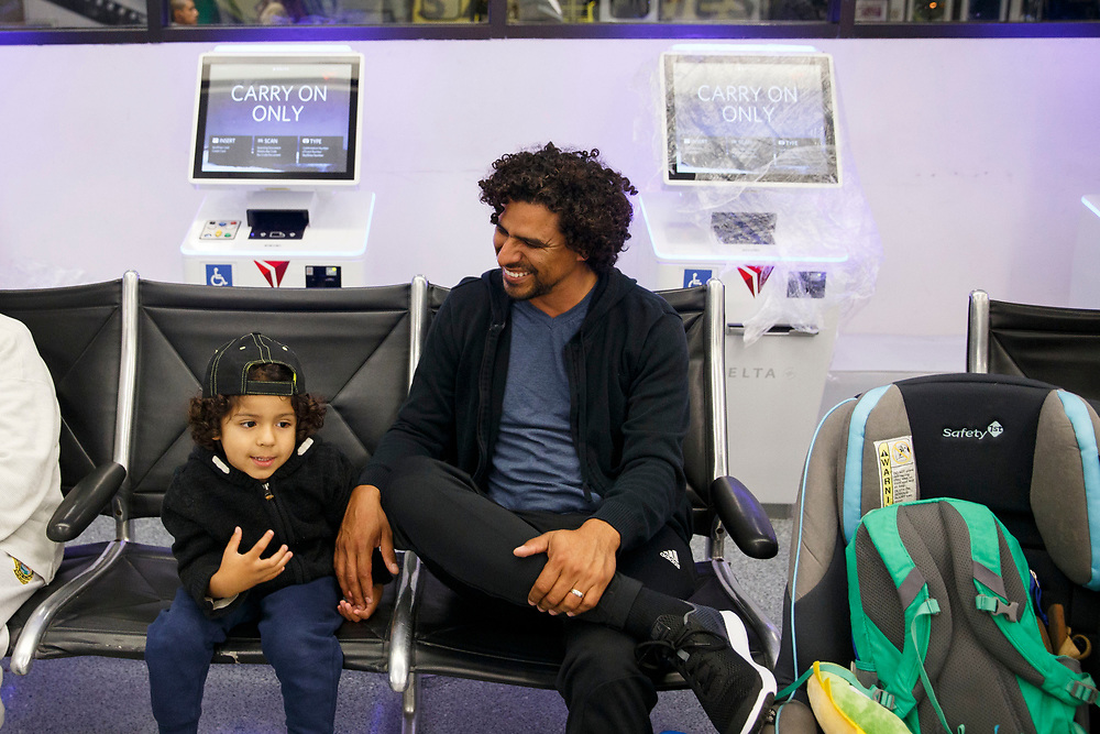 Jonathan Aldama and son Elias, 3, of Anaheim, wait for their Frontier Airlines flight to Florida in in Terminal 3, in from of wrapped Delta Airlines check-in kiosks as the airline relocation begins at Los Angles International Airport (LAX) on Friday, May 12, 2017 in Los Angeles, Calif. Delta Airlines will move from Terminals 5 and 6 to Terminals 2 and 3, forcing 19 other carriers to shift their operations into the facilities vacated by Delta.  © 2017 Patrick T. Fallon
