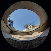 "Taken on May 6, 2015, at the African Burying Ground Memorial in Portsmouth NH, during a ""dry run"" of fitting the new coffins into the crypt a few weeks before the memorial's official opening. This is a fisheye view looking up/out of the crypt."
