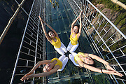YUEYANG, CHINA - NOVEMBER 05: (CHINA OUT) <br /> <br /> 100 Girls Do Yoga On Glass Suspension Bridge <br /> <br /> Yoga enthusiasts practice on a glass suspension bridge at the Shiniuzhai National Geological Park on November 5, 2015 in Pingjiang County, Yueyang City, Hunan Province of China. 100 yoga enthusiasts practice on the glass suspension bridge with a length of 300 meters and a maximum height of 180 meters at the Shiniuzhai National Geological Park in Pingjiang. <br /> ©Exclusivepix Media