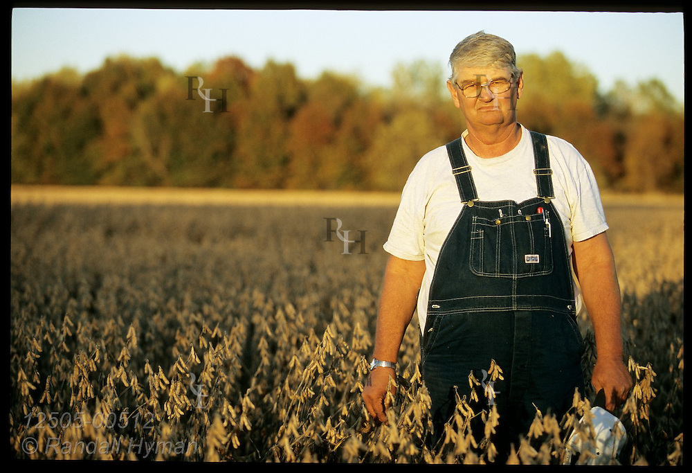 Farmer Terry Albertson poses in field of soybeans ready for harvest on an October afternoon near Chillicothe, Missouri