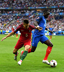 Moussa Sissoko of France battles for the ball with Raphael Guerreiro of Portugal  - Mandatory by-line: Joe Meredith/JMP - 10/07/2016 - FOOTBALL - Stade de France - Saint-Denis, France - Portugal v France - UEFA European Championship Final