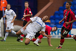 BIRKENHEAD, ENGLAND - Saturday, October 2, 2010: Tranmere Rovers' Joss Labadie is tackled by Brighton & Hove Albion's Matthew Sparrow during the Football League One match at Prenton Park. (Photo by Vegard Grott/Propaganda)