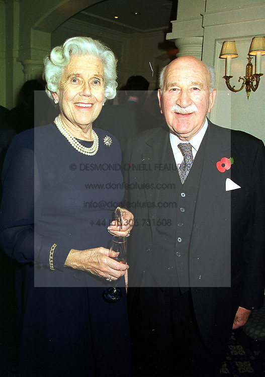 MAJOR EDMUND & MRS DE ROTHSCHILD at a party in London on 9th November 1999.MYW 36