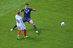LENS, FRANCE - Thursday, June 16, 2016: Wales' Hal Robson-Kanu in action against England's Wayne Rooney during the UEFA Euro 2016 Championship Group B match at the Stade Bollaert-Delelis. (Pic by Paul Greenwood/Propaganda)