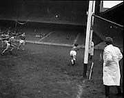 01/11/1970<br /> 11/01/1970<br /> 1 November 1970<br /> All-Ireland Under-21 Hurling Final: Cork v Wexford at Croke Park, Dublin. <br /> Confusion at the Wexford goal as the ball was in, then it was out. The umpire had seen the score and reached for the green flag while P. Ring and B. Cummins were still ready to take advantage if the whistle had not gone.