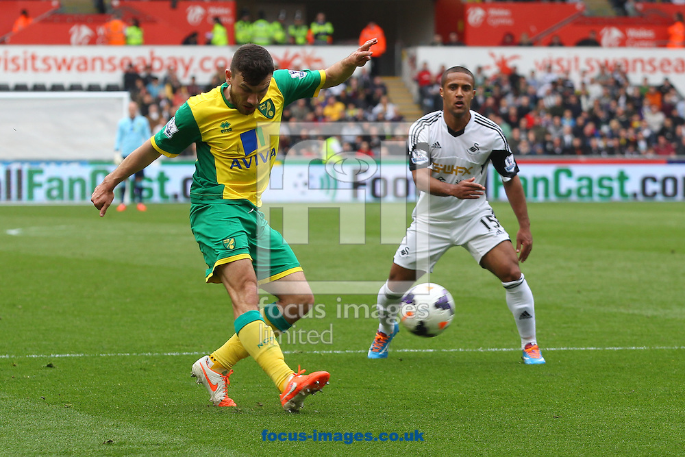 Robert Snodgrass of Norwich crosses the ball during the Barclays Premier League match at the Liberty Stadium, Swansea<br /> Picture by Paul Chesterton/Focus Images Ltd +44 7904 640267<br /> 29/03/2014