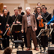 """March 27, 2012 - New York, NY : Composter John Adams, center, takes a bow after the San Francisco Symphony performed the New York premiere of his composition """"Absolute Jest"""" in Carnegie Hall's Stern Auditorium on Tuesday evening.  CREDIT : Karsten Moran for The New York Times"""