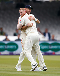 England's Ben Stokes (left) celebrates with James Anderson after taking the wicket of Pakistan's Asad Shafiq for 59 during day two of the First NatWest Test Series match at Lord's, London.