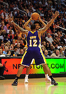 Oct. 29 2010; Phoenix, AZ, USA; Phoenix Suns guard Josh Childress (1) handles the ball against Los Angeles Lakers guard-forward Shannon Brown (12) during the first half at the US Airways Center. The Lakers defeated the Suns 114-106.  Mandatory Credit: Jennifer Stewart-US PRESSWIRE.