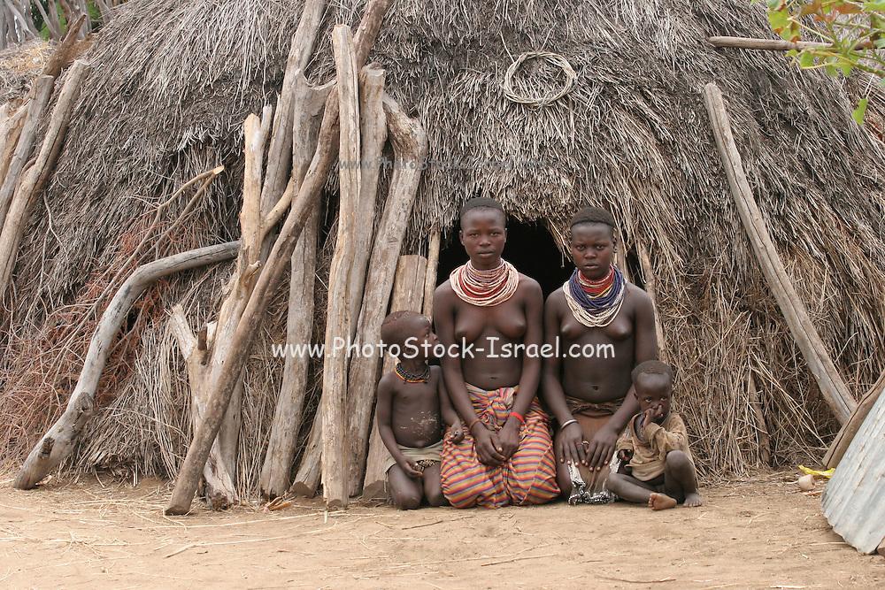 Africa, Ethiopia, Omo Valley, Daasanach tribe women in front of hut