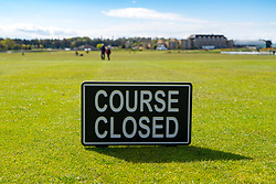 St Andrews, Scotland, UK. 4 May 2020.  The famous Old Course at St Andrews is closed due to the coronavirus lockdown. Locals are making the most of the closed golf course by using it as a park for they daily exercise. Pictured; Course closed sign on first tee. Iain Masterton/Alamy Live News