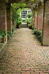 The pergola with decorative brick paving