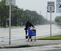 September 10, 2017 - Florida, U.S. - US1 in Lantana is deserted with the exception of a woman pushing a shopping cart as winds and rain from Hurricane Irma move into the area on Sunday, September 10, 2017. (Credit Image: © Bruce R. Bennett/The Palm Beach Post via ZUMA Wire)