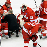 11 April 2009:   Miami University goalie Cody Reichard (30) is consoled by head coach Enrico Blasi after the Boston University Terriers came back from a 2 goal deficit to win the the Division I Mens Ice Hockey Championship 4-3 in overtime at the Verizon Center in Washington, DC.