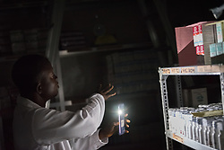 2 November 2019, Ganta, Liberia: Pharmacist Joseph G. Karlea shows the medical supplies at Ganta Hospital. Located in Nimba county, the Ganta United Methodist Hospital serves tens of thousands of patients each year. It is a founding member of the Christian Health Association of Liberia.