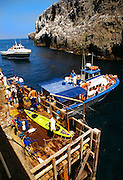 350605-1049B ~ Copyright:  George H. H. Huey ~ Landing Cove, with boats [loading and unloading passengers].  East Anacapa Island.  Channel Islands National Park, California.