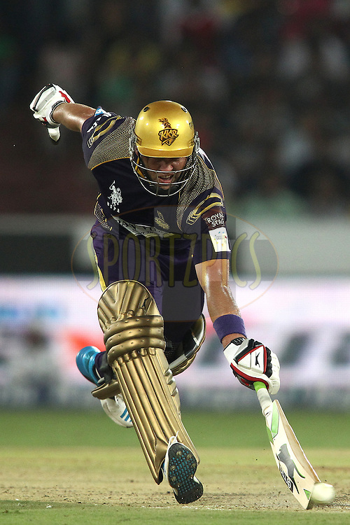 Jacques Kallis of the Kolkata Knight Riders scrambles for a run during the first semi final match of the Oppo Champions League Twenty20 between the Kolkata Knight Riders and the Hobart Hurricanes held at the Rajiv Gandhi Cricket Stadium, Hyderabad, India on the 2nd October 2014<br /> <br /> Photo by:  Shaun Roy / Sportzpics/ CLT20<br /> <br /> <br /> Image use is subject to the terms and conditions as laid out by the BCCI/ CLT20.  The terms and conditions can be downloaded here:<br /> <br /> http://sportzpics.photoshelter.com/gallery/CLT20-Image-Terms-and-Conditions-2014/G0000IfNJn535VPU/C0000QhhKadWcjYs