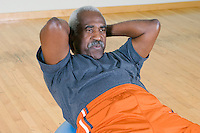 Senior Man Doing Sit-Ups on Exercise Ball