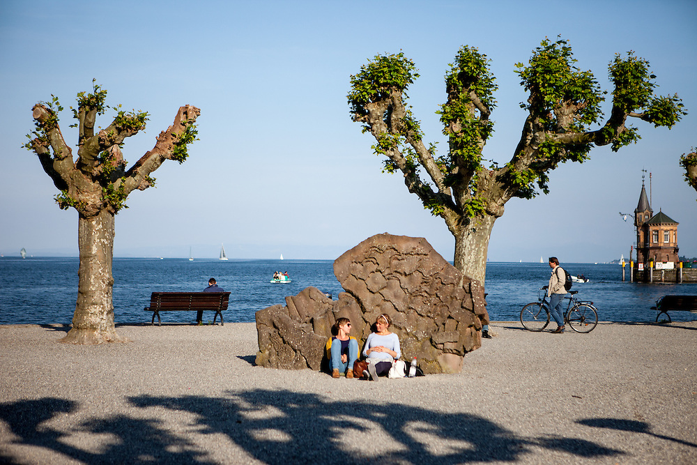 Visitors and inhabitants relaxing at the harbour of Lake Constance (Bodensee).
