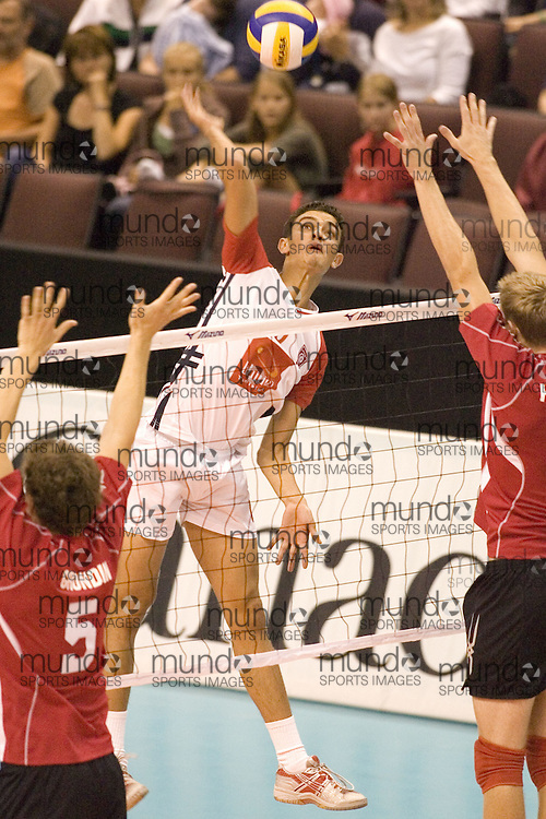 Aymen Ben Brik of Tunisia defeating Canada Two three games to none in the 2006 Anton Furlani Volleyball Cup, held in Ottawa, Canada. .Anton Furlani Cup.Copyright Sean Burges / Mundo Sport Images, 2006