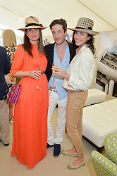 Left to right, FIAMMETTA EGALINI, BLAISE PATRICK and YOSUZI SYLVESTER at the St.Regis International Polo Cup at Cowdray Park, Midhurst, West Sussex on 16th May 2015.
