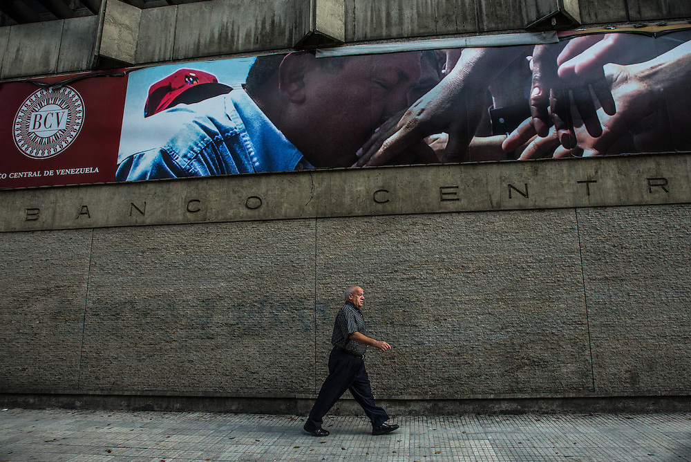 "CARACAS, VENEZUELA -MARCH 22, 2016: People walk past the Central Bank of Venezuela in downtown Caracas on Tuesday morning.  Venezuela is shutting down this week, as the government struggles with a deepening electricity crisis.  President Nicolas Maduro gave everyone an extra three days off work, extending the two-day Easter holiday, according to a statement in the Official Gazette published late last Tuesday.  The government has rationed electricity and water supplies across the country for months and urged citizens to avoid waste as Venezuela endures a prolonged drought that has slashed output at hydroelectric dams. The ruling socialists have blamed the shortage on the El Nino weather phenomena and ""sabotage"" by their political foes, while critics cite a lack of maintenance and poor planning.  PHOTO: Meridith Kohut for Bloomberg News"
