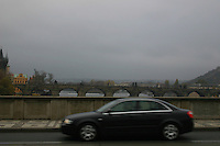 Car travelling over the bridge on River Vltava, Prague, Czech Republic<br />