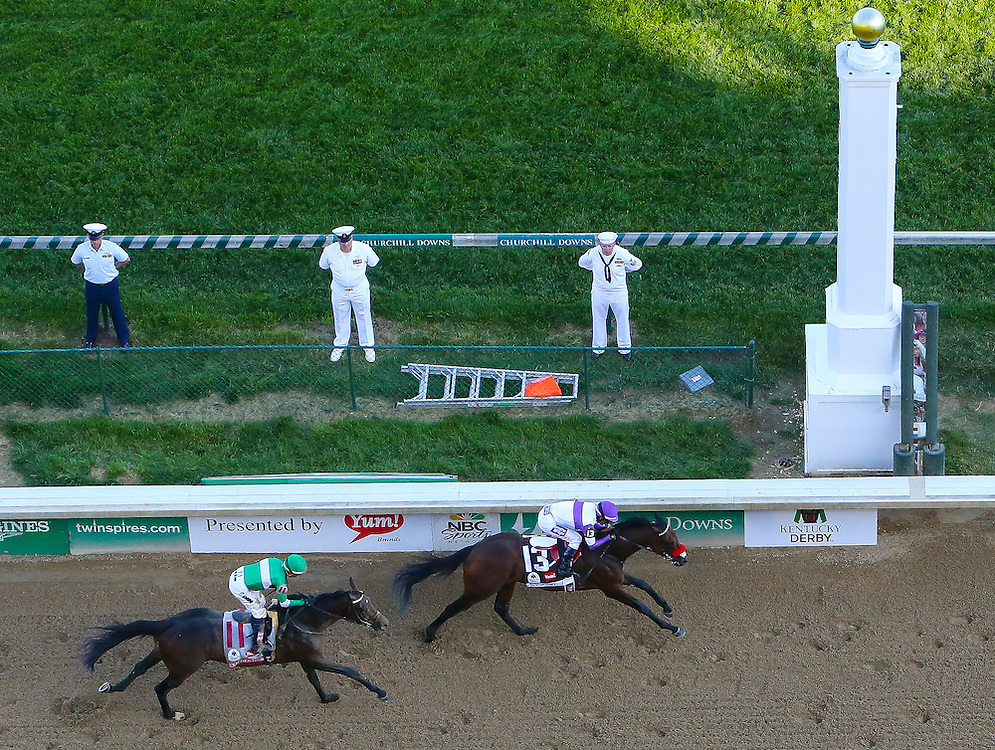 LOUISVILLE, KY - MAY 7:  Nyquist#13, ridden by Mario Gutierrez, wins the 142nd running of the Kentucky Derby ahead of Exaggerator #11, ridden by Kent Desormeaux, at Churchill Downs on May 7, 2016 in Louisville, Kentucky. (Photo by Michael Reaves/Getty Images)
