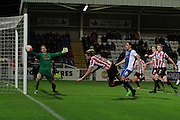 Harry Pell heads off the post in the final minutes during the The FA Cup match between Hartlepool United and Cheltenham Town at Victoria Park, Hartlepool, England on 7 November 2015. Photo by Antony Thompson.