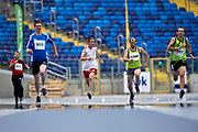 Chorzow, Poland - 2018 June 10: Special Olympics Athlete (C) Tomasz Warzycki runs in men's 200m heat while athtletics competition during National Special Olympics Games 2018 at Slaski Stadium on June 10, 2018 in Chorzow, Poland.<br /> <br /> Adam Nurkiewicz declares that he has no rights to the image of people at the photographs of his authorship.<br /> <br /> Picture also available in RAW (NEF) or TIFF format on special request.<br /> <br /> Any editorial, commercial or promotional use requires written permission from the author of image.<br /> <br /> Image can be used in the press when the method of use and the signature does not hurt people on the picture.<br /> <br /> Mandatory credit:<br /> Photo by &copy; Adam Nurkiewicz / Mediasport