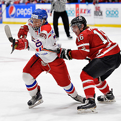 WHITBY, - Dec 16, 2015 -  Game #8 - Czech Republic vs. Canada East at the 2015 World Junior A Challenge at the Iroquois Park Recreation Complex, ON. Tomas Havranek #20 of Team Czech Republic battles for position with Makail Parker #16 of Team Canada East during the first period.<br /> (Photo: Shawn Muir / OJHL Images)