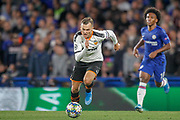 Valencia midfielder Denis Cheryshev (11) sprints ahead of Chelsea midfielder Willian (10) during the Champions League match between Chelsea and Valencia CF at Stamford Bridge, London, England on 17 September 2019.