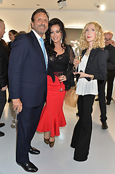 Left to right, SIR ROCCO FORTE, NANCY DELL'OLIO and BASIA BRIGGS at a private view of Dancing Away featuring work by Mikhail Baryshnikov held at ContiniArtUK, 105 New Bond Street, London on 27th November 2014.