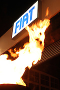 FIAT sign with fire from a pyre, on Thursday, Jan. 19, 2006. **ITALY OUT**
