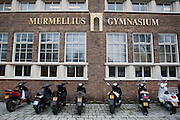 Scooters voor het Murmellius Gymnasium in Alkmaar.<br /> <br /> Scooters in front of the Murmellius Gymnasium, a high school, in Alkmaar.