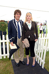 DJ MIKE READ and CHARLOTTE REDFORD at the Kuoni World Clas Polo Cup in aid of Breast Cancer Care held at Hurtwood Park Polo Club, Ewhurst, Surrey on 27th May 2007.<br />