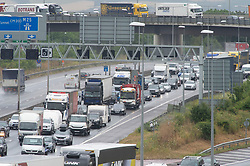 © Licensed to London News Pictures. 19/07/2019.<br /> Dartford,UK.Anti-clockwise traffic towards Dartford crossing. Frantic Friday Getaway on the M25 near Dartford in Kent. Rain and heavy traffic this afternoon as the the schools break up for the summer holiday.  Photo credit: Grant Falvey/LNP