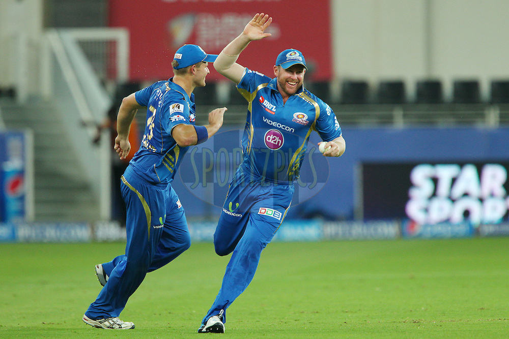 Ben Dunk of the Mumbai Indians celebrates taking the catch to dismiss Aaron Finch of the Sunrisers Hyderabad during match 20 of the Pepsi Indian Premier League Season 2014 between the Mumbai Indians and the Sunrisers Hyderabad held at the Dubai International Stadium, Dubai, United Arab Emirates on the 30th April 2014<br /> <br /> Photo by Ron Gaunt / IPL / SPORTZPICS