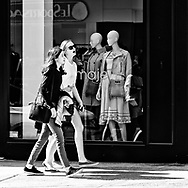 The Mannequins of Madison Avenue watch the world go by.