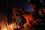 BEA AHBECK/bahbeck@mercedsun-star.com<br /> (second from right) sisters Harpreet Pabla, 16, and Harsimren Pabla, 11, both of Livingston, light candles during the Diwali festival in Livingston, Calif. Wed. Oct. 26, 2011.