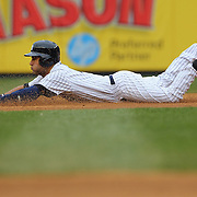 Derek Jeter, Yankees, dives into second on a double during the fifth inning during the New York Yankees V Baltimore Orioles home opening day at Yankee Stadium, The Bronx, New York. 7th April 2014. Photo Tim Clayton